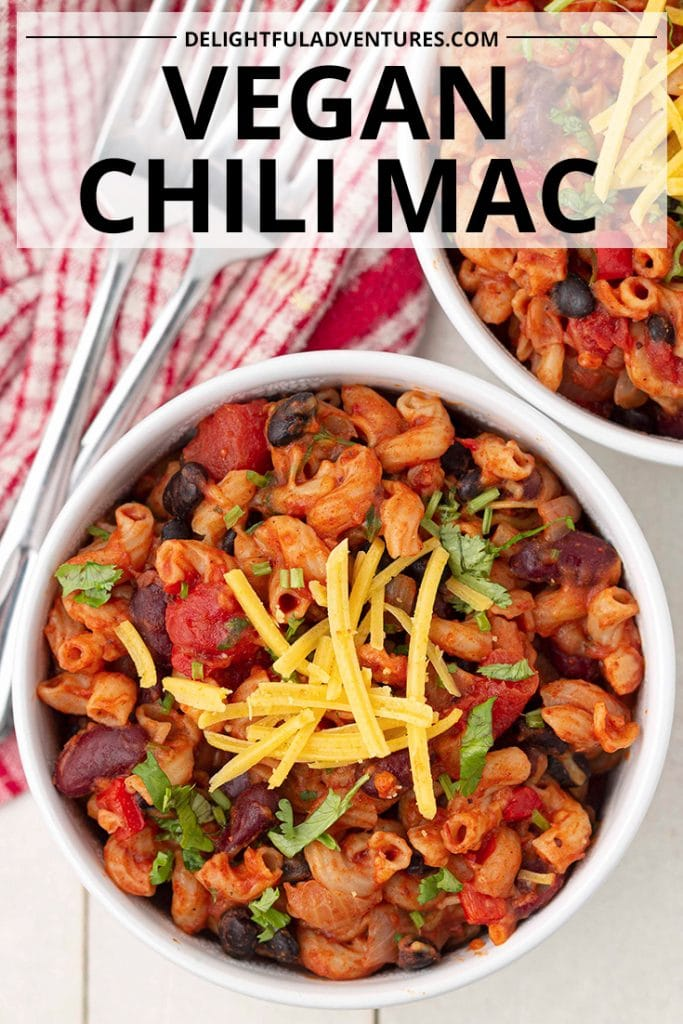Pinterest pin showing an overhead shot of a bowl of vegan chili mac, this image is to be used to pin this recipe to Pinterest.