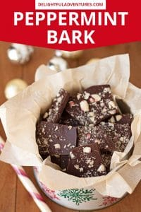 Pinterest pin showing an overhead shot of a tin full of peppermint bark, this image is to be used to pin this recipe to Pinterest.