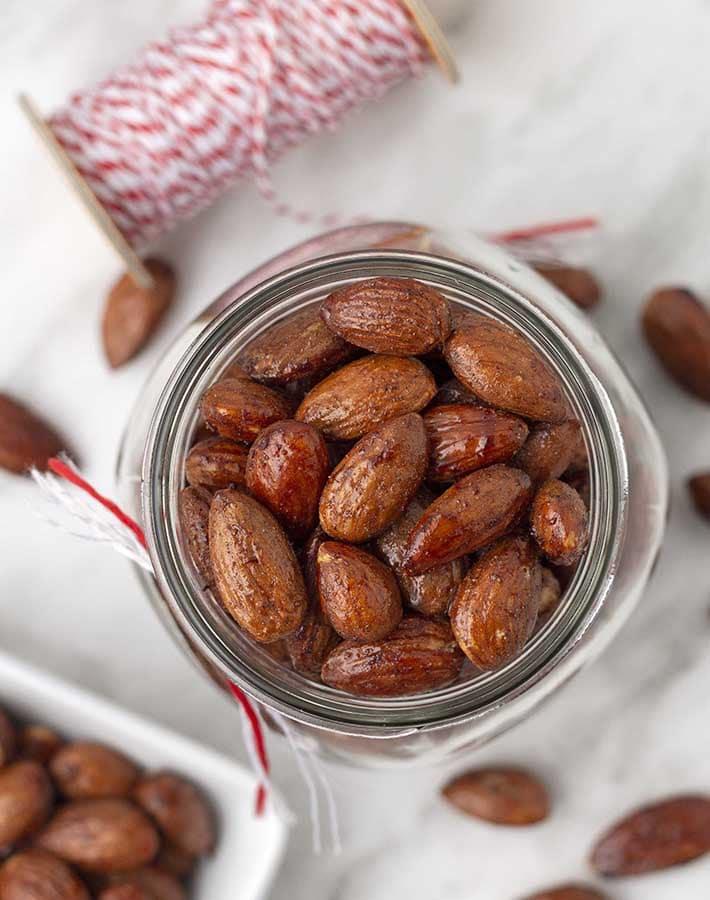 Overhead shot of an open jar of maple almonds.