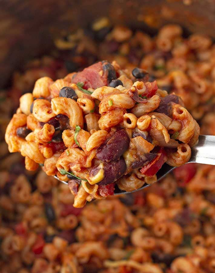 A spoon full of vegan chili macaroni.