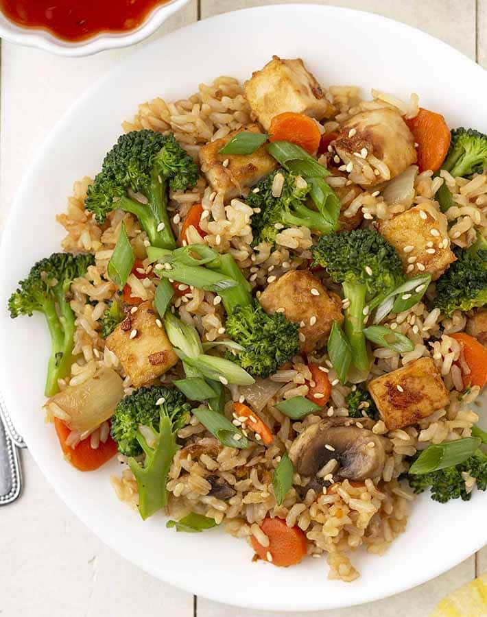 Overhead image of vegan fried brown rice with lots of veggies on a plate.