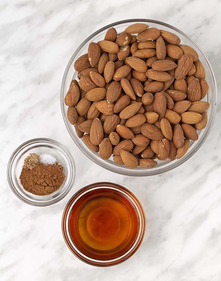 Ingredients needed to make maple syrup almonds.