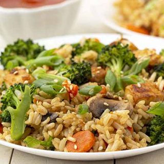 Close up shot of vegan fried rice on a white plate.