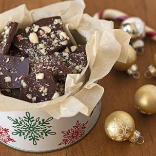A holiday tin full of homemade chocolate peppermint bark.