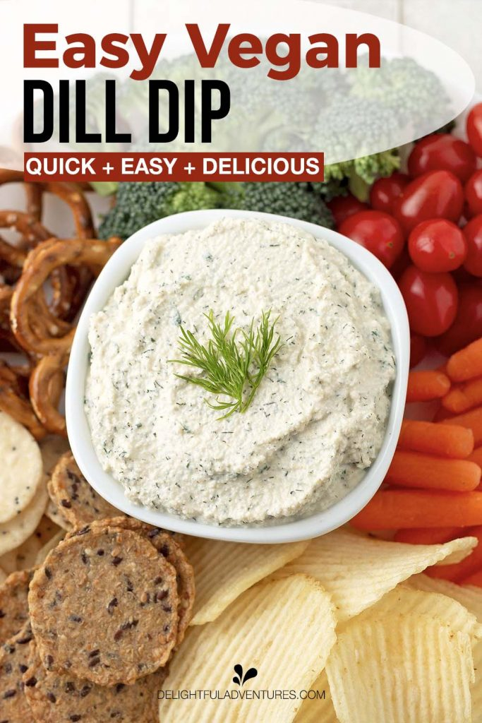 Pinterest pin showing an overhead shot of a bowl of vegan dill dip surrounded by vegetables, chips, crackers, and pretzels for dipping, this image is to be used to pin this recipe to Pinterest.
