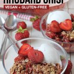 Pinterest pin showing a glass bowl of strawberry rhubarb crisp, this image is to be used to pin this recipe to Pinterest.