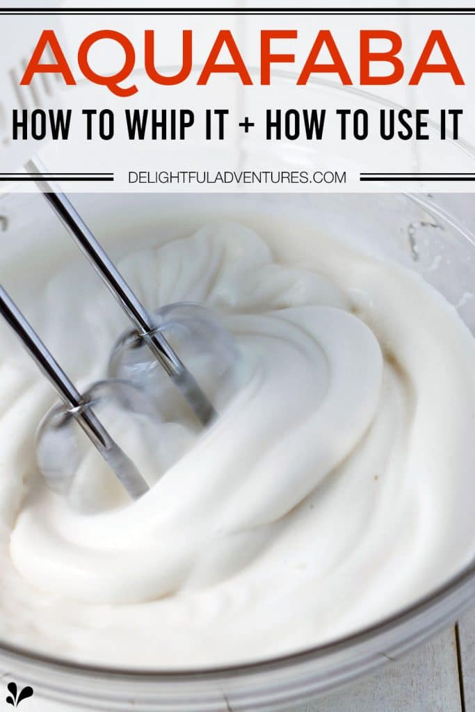 Pinterest pin showing a glass bowl of aquafaba being whipped with a hand mixer, this image is to be used to pin this recipe to Pinterest.