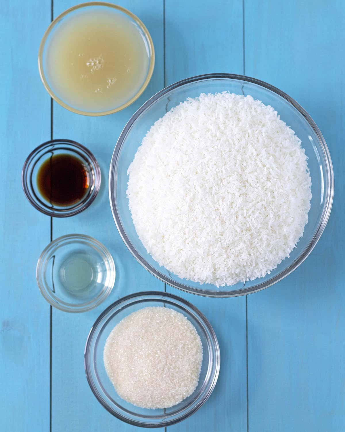 Overhead shot of the five ingredients needed to make this vegan coconut macaroon recipe.