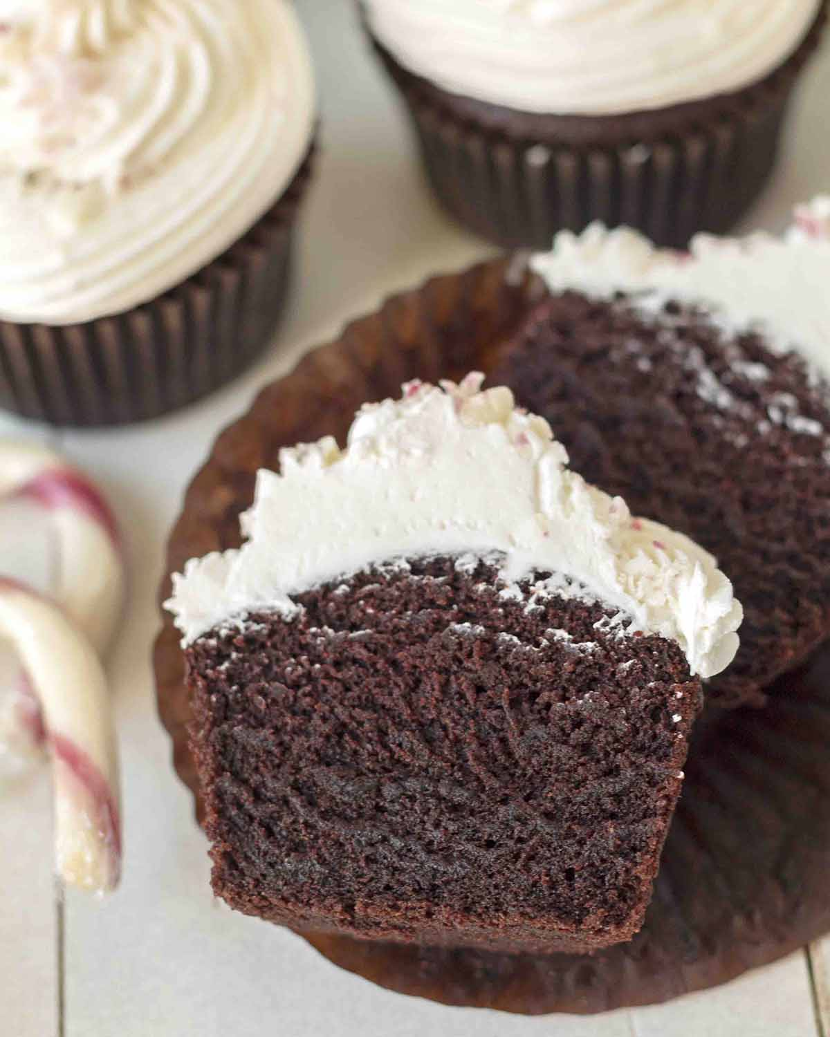 An overhead shot of chocolate mint cupcake split in half to show the soft inner texture.