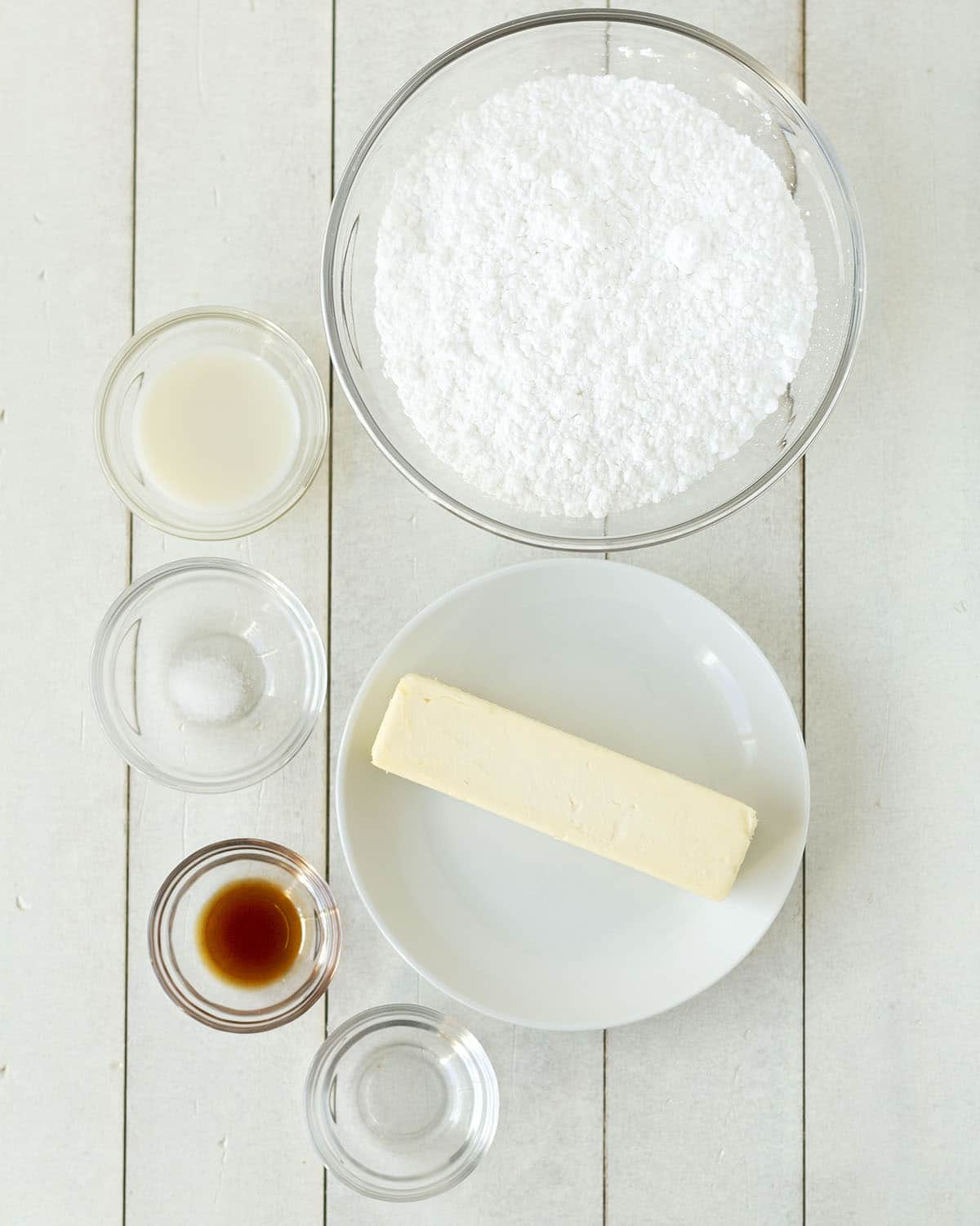 Overhead shot showing the ingredients needed to make mint buttercream frosting.