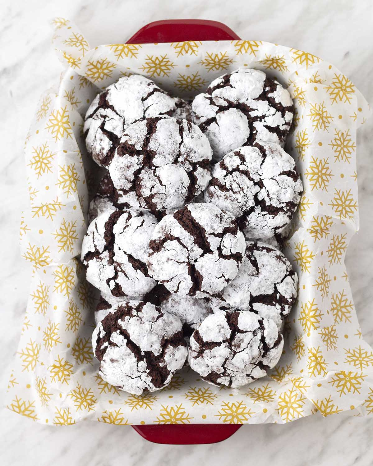 An overhead picture of a dish filled with gluten-free vegan chocolate crinkle cookies.