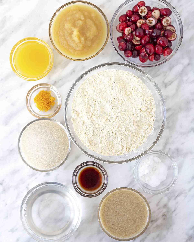 An overhead shot of the ingredients needed to make vegan gluten-free cranberry orange muffins.