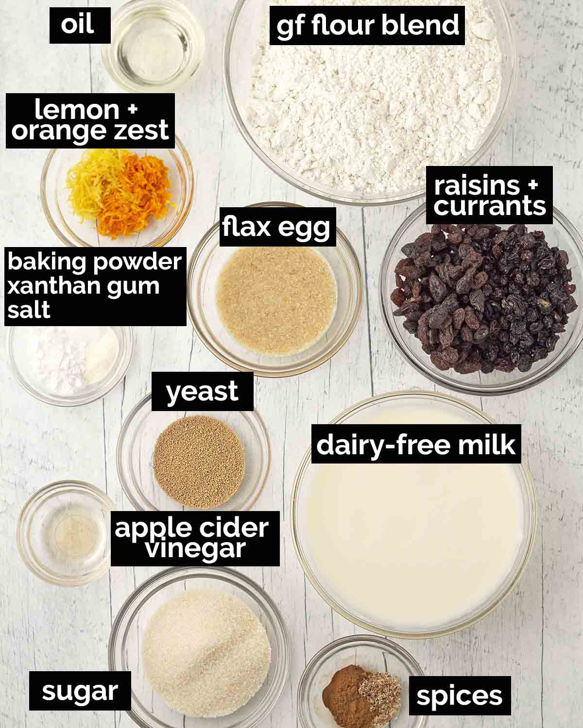 Overhead shot showing all the ingredients needed to make wheat free hot cross buns.