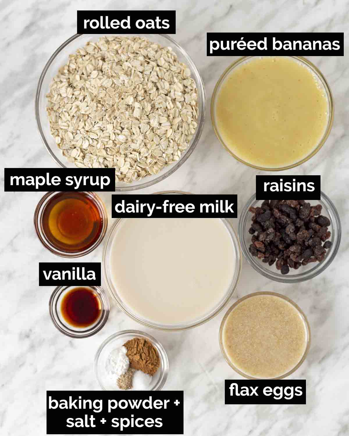 An overhead shot showing all the ingredients needed to make vegan baked oatmeal with bananas.