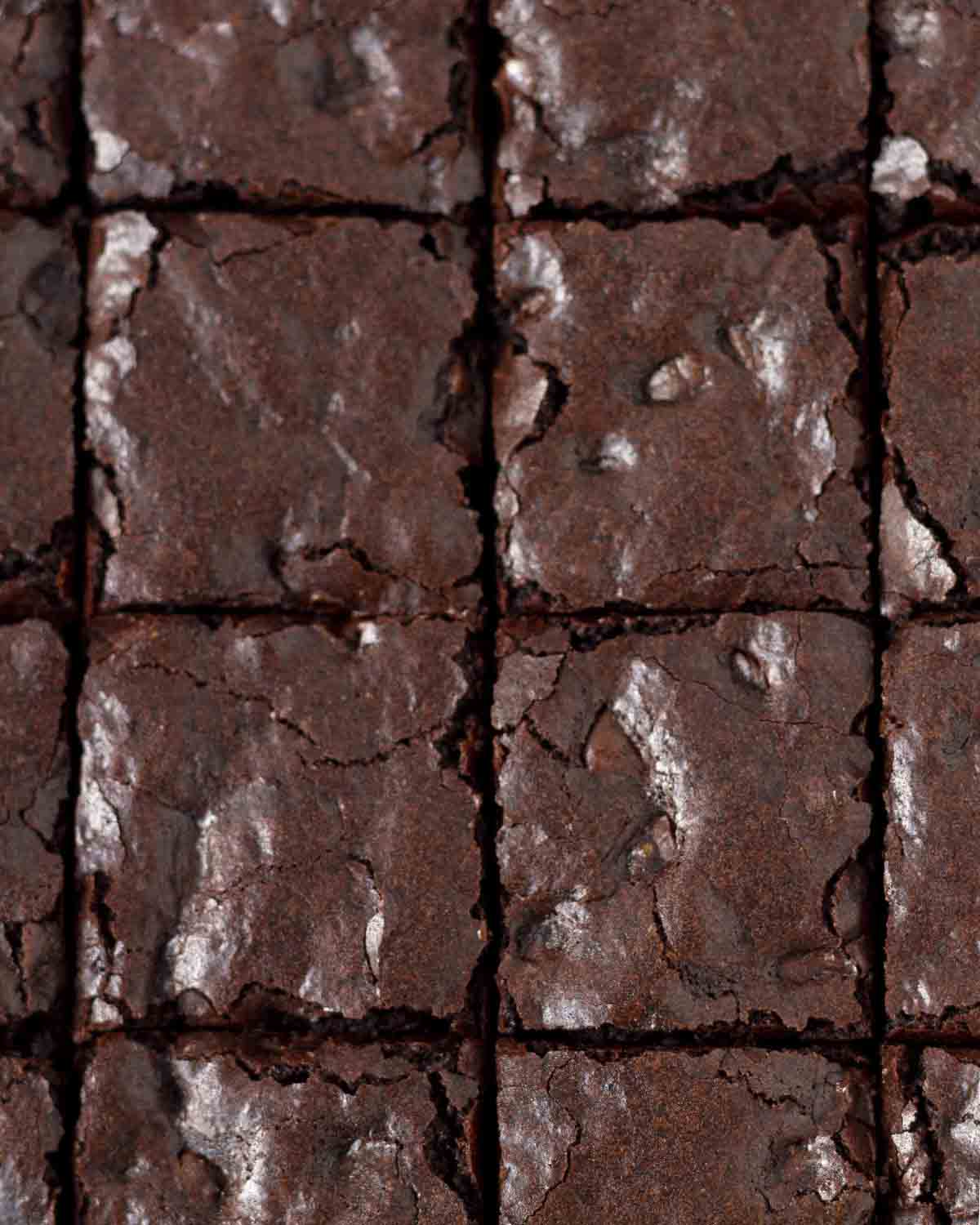 An overhead shot of sliced vegan gluten-free brownies, the shot shows that the brownies have a crinkly, crackly top.