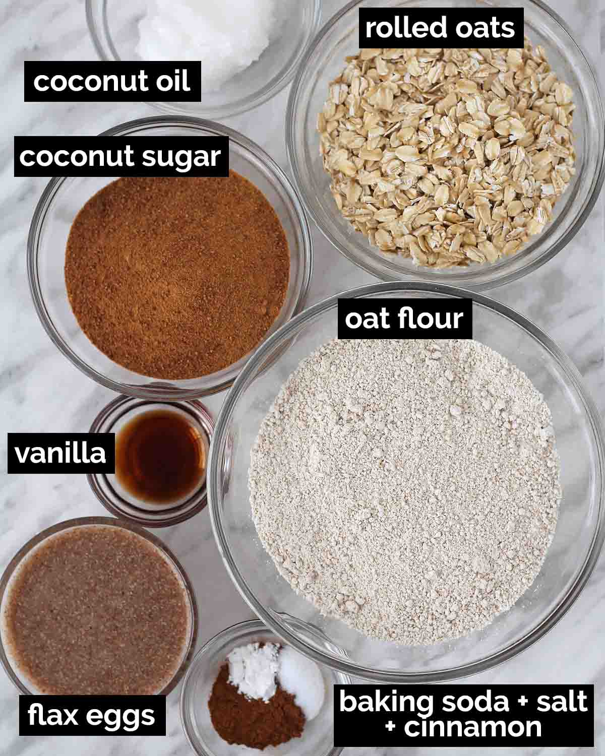 An overhead shot showing the ingredients needed to make dairy-free oatmeal cookies.