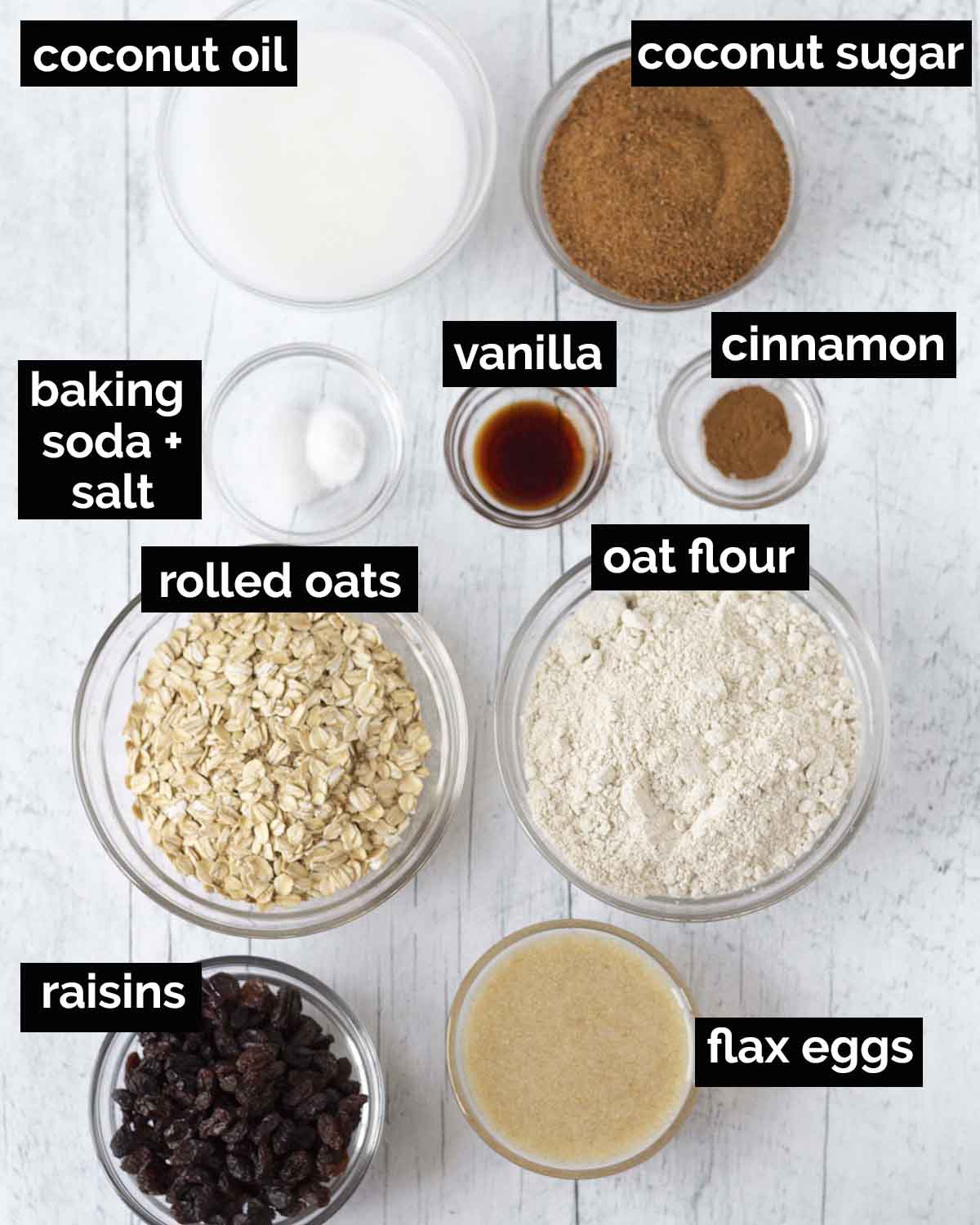 An overhead shot showing all the ingredients needed to make soft and chewy vegan oatmeal raisin cookies.